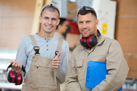 a portrait of two workers