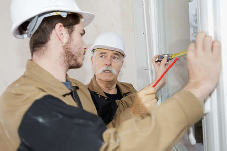 a workers installing a window Stock fotó