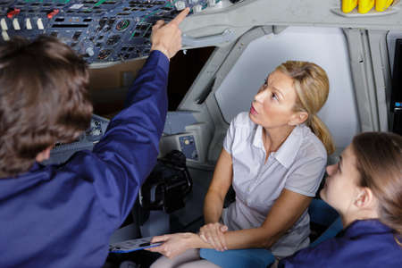 students training in aircraft cockpit