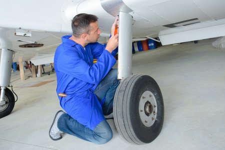 Mechanic working on aircraft landing gear