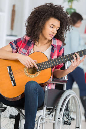 a disabled girl playing guitar