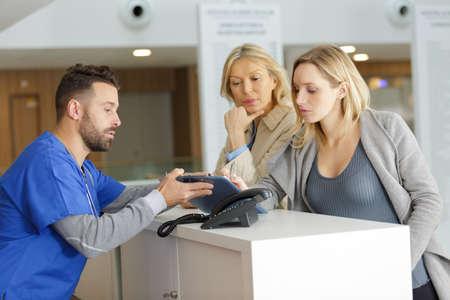 young pregnant woman at a doctors reception