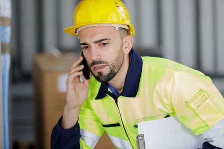 male engineer on the phone