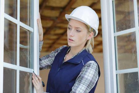 female window fitter using screwdriver