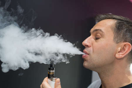 a man smoking electronic cigarette Foto de archivo
