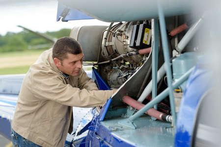an aircraft maintenance engineer at work Stock Photo