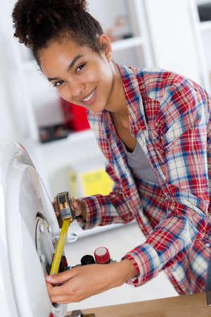 female plumber measuring a boiler Reklamní fotografie
