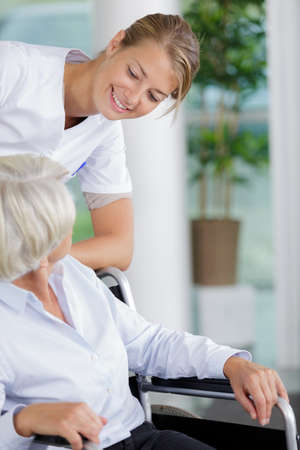 nurse caring about elder woman Stock Photo