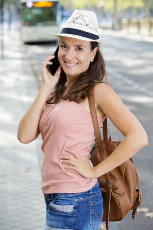 woman on phone wearing hat outdoors 写真素材