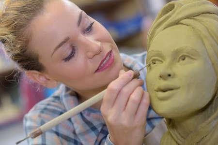 Woman is enhancing eye details