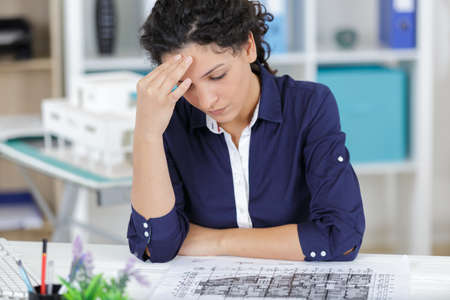 businesswoman in office looking worried