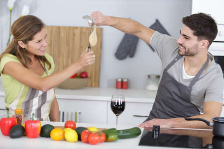 portrait of a cheerful couple cooking