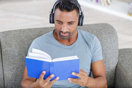 man listening to audiobook through headphones