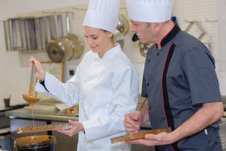chef and assistant creating new pastries