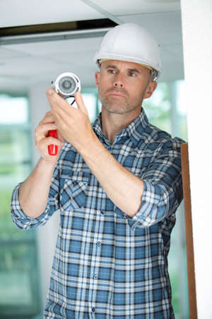 professional cctv technician installing camera