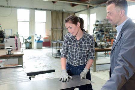 woman working with sheet metal