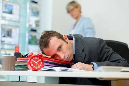 tired and sleepy business man at his workplace