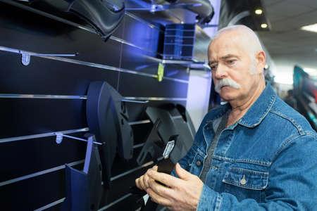senior man in furnishings retail store