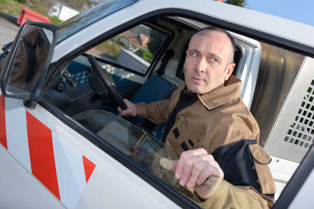 a man entering works vehicle
