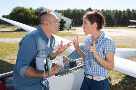 Man and woman having an argument in the gliding field