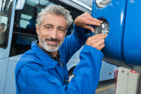 attractive mechanic working at the garage Stock Photo