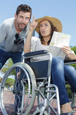 woman in wheelchair pointing into distance