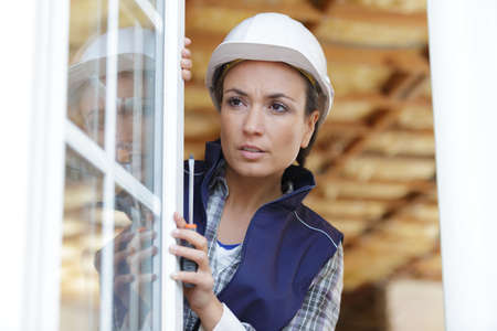 female window fitter holding screwdriver