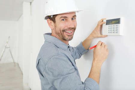 a builder regulating the temperature Banco de Imagens