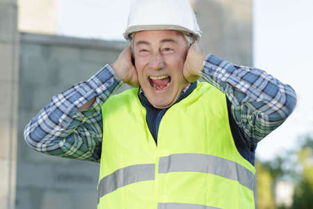 construction suffering from noise pollution on building site Stock fotó