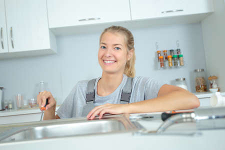 a woman in equality plumbing industry Imagens