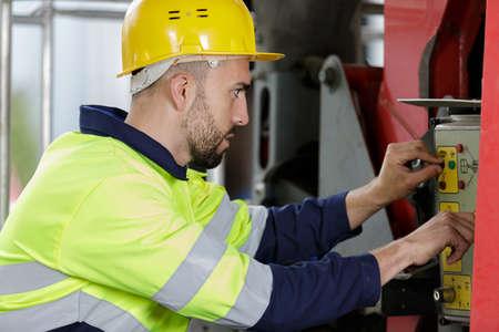 industrial worker operating near metal machining industry