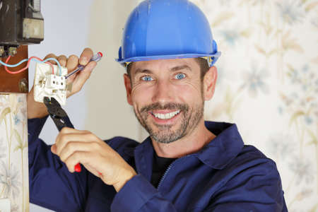 an electrician looks at camera Stockfoto
