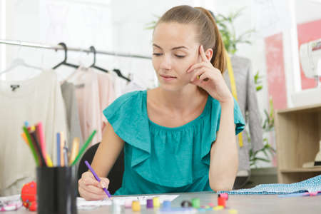 a young clothing designers workshop Banco de Imagens