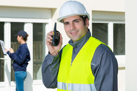 picture of construction foreman using walkie talkie Фото со стока