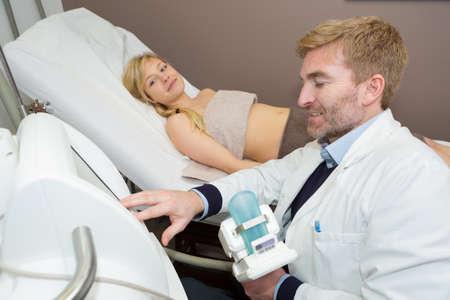 gynecologist examining a patient Foto de archivo