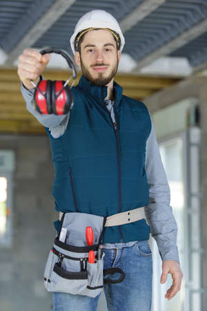attractive and confident constructor with ear protection gear