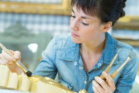 woman painting a frame Reklamní fotografie