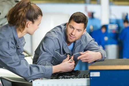 apprentice mechanic choosing socket from toolbox drawer