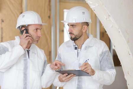 busy construction engineer talking on phone Фото со стока