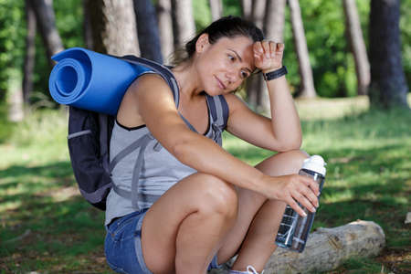 happy but tired female hiker in nature