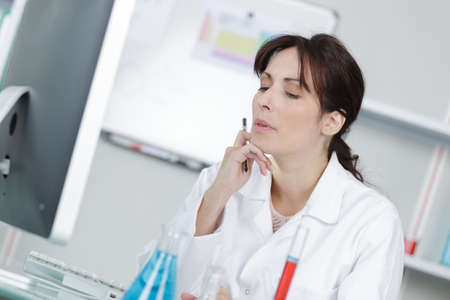 a female scientist during contemplation