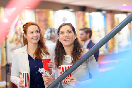 women walking on the cinema lobby