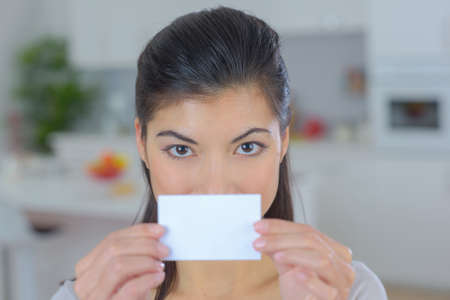 woman holding a napkin to cover her mouth