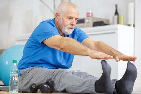 senior man warmup stretching training indoors Imagens