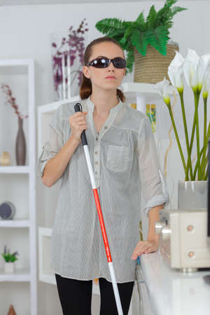 young visually impaired woman at home