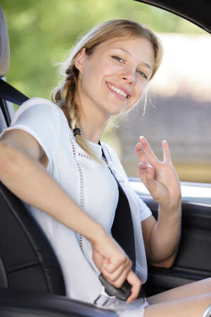 beautiful lady showing okay sign from her car Banque d'images