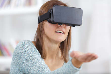 young attractive happy woman using 3d goggles enjoying cyber fun