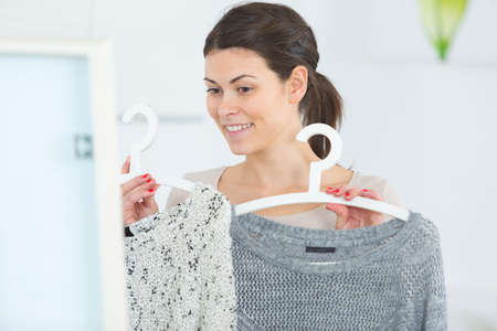 young cheerful woman choosing what to wear