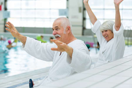 elderly couple near swimming pool