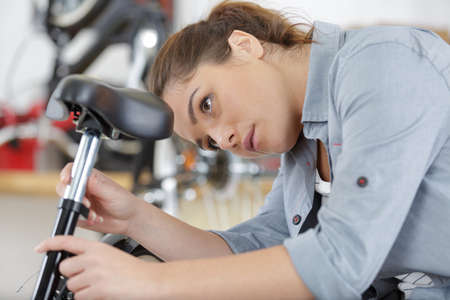 young man and woman choosing sport bike in bicycle store